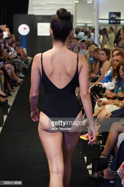 A model walks the runway at the Saks Fifth Avenue presentation at Miami Swim Week Powered by Art Hearts Fashion on July 16 2018 in Miami Florida