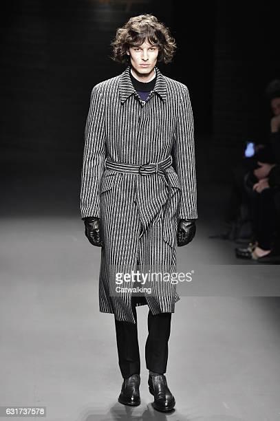 Model walks the runway at the Salvatore Ferragamo Autumn Winter 2017 fashion show during Milan Menswear Fashion Week on January 15, 2017 in Milan,...