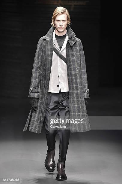 A model walks the runway at the Salvatore Ferragamo Autumn Winter 2017 fashion show during Milan Menswear Fashion Week on January 15 2017 in Milan...