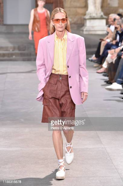 Model walks the runway at the Salvatore Ferragamo fashion show in Piazza della Signoria during Pitti Immagine Uomo 96 on June 11, 2019 in Florence,...