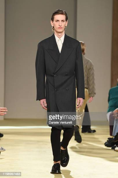 A model walks the runway at the Salvatore Ferragamo fashion show on January 12 2020 in Milan Italy