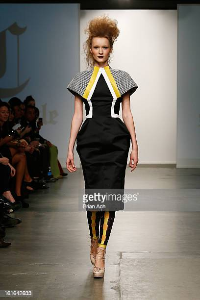 A model walks the runway at the Samantha Cole London show during Nolcha Fashion Week New York 2013 presented by RUSK at Pier 59 Studios on February...