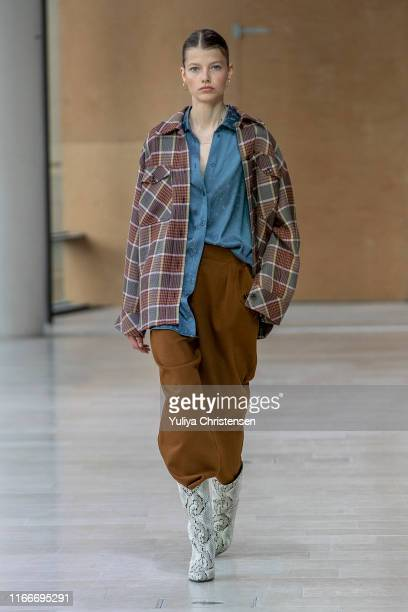 Model walks the runway at the Samsoe Samsoe show during the Copenhagen Fashion Week Spring/Summer 2020 on August 07, 2019 in Copenhagen, Denmark.