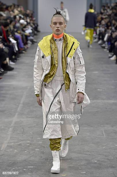 A model walks the runway at the Sankuanz Autumn Winter 2017 fashion show during Paris Menswear Fashion Week on January 22 2017 in Paris France
