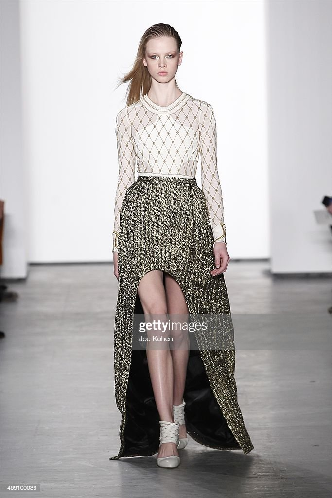 A model walks the runway at the Sass & Bide fashion show during Mercedes-Benz Fashion Week Fall 2014 at The Waterfront on February 12, 2014 in New York City.