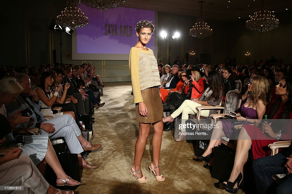 A model walks the runway at the Sava Nald Show during the Mercedes-Benz Fashion Week Spring/Summer 2014 at Hotel Adlon on July 4, 2013 in Berlin, Germany.