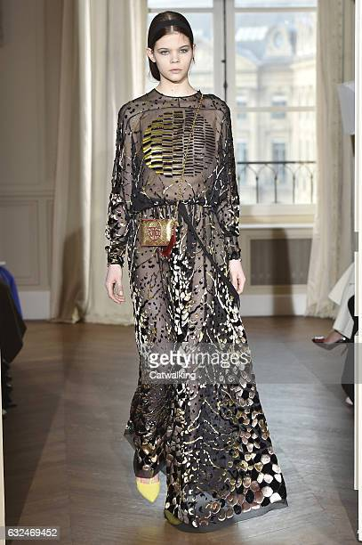 Model walks the runway at the Schiaparelli Spring Summer 2017 fashion show during Paris Haute Couture Fashion Week on January 23, 2017 in Paris,...