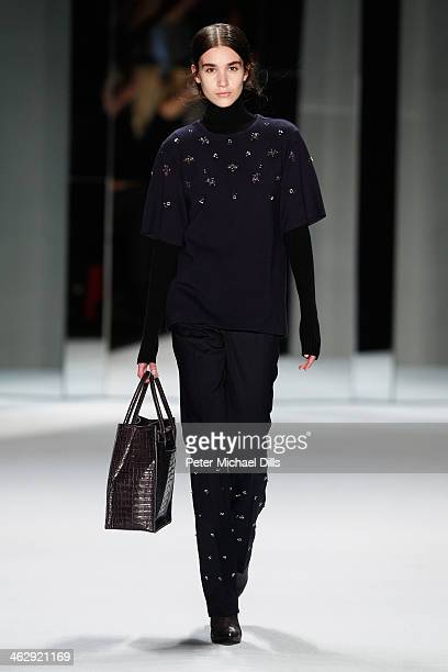 A model walks the runway at the Schumacher show during MercedesBenz Fashion Week Autumn/Winter 2014/15 at Brandenburg Gate on January 16 2014 in...