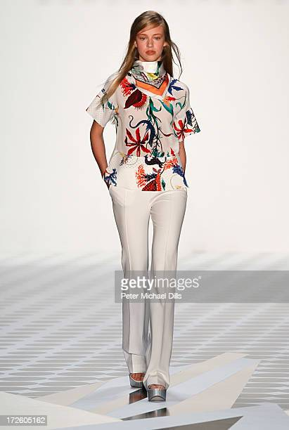 Model walks the runway at the Schumacher Show during the Mercedes-Benz Fashion Week Spring/Summer 2014 at Brandenburg Gate on July 4, 2013 in Berlin,...