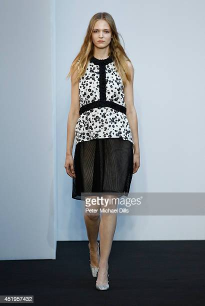 A model walks the runway at the Schumacher show during the MercedesBenz Fashion Week Spring/Summer 2015 at Sankt Elisabeth Kirche on July 10 2014 in...