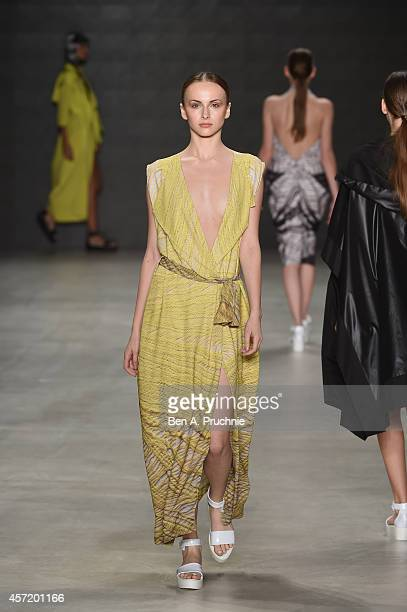 A model walks the runway at the Selim Baklaci show during Mercedes Benz Fashion Week Istanbul SS15 at Antrepo 3 on October 14 2014 in Istanbul Turkey