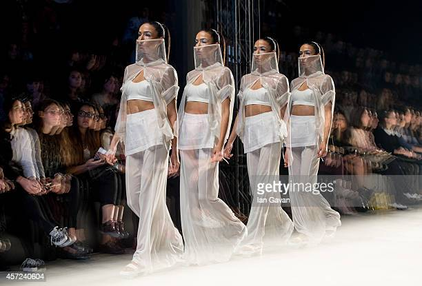 A model walks the runway at the Selma State show during Mercedes Benz Fashion Week Istanbul SS15 at Antrepo 3 on October 15 2014 in Istanbul Turkey