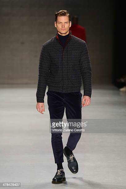 A model walks the runway at the Serdar Uzuntas show during MBFWI presented by American Express Fall/Winter 2014 on March 13 2014 in Istanbul Turkey
