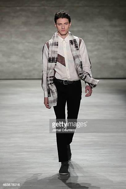 Model walks the runway at the SERGIO DAVILA fashion show during Mercedes-Benz Fashion Week Fall 2015 at The Pavilion at Lincoln Center on February...