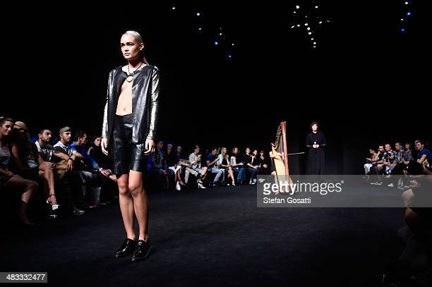 A model walks the runway at the Serpent The Swan show during MercedesBenz Fashion Week Australia 2014 at Carriageworks on April 8 2014 in Sydney...