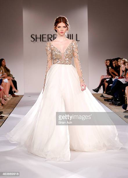 A model walks the runway at the Sherri Hill fashion show during MercedesBenz Fashion Week Fall 2015 at The Plaza on February 19 2015 in New York City