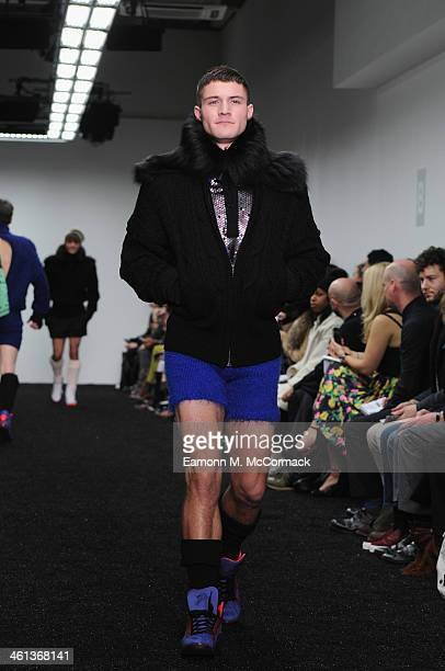 A model walks the runway at the Sibling show during The London Collections Men Autumn/Winter 2014 on January 8 2014 in London England
