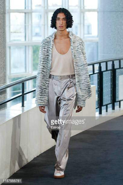A model walks the runway at the Sies Marjan show during Paris Men's Fashion Week Spring/Summer 2020 on June 22 2019 in Paris France