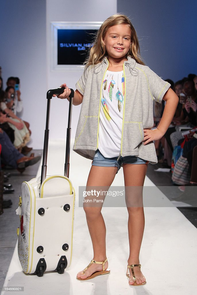 A model walks the runway at the Silvian Heach show during Petite Parade NY Kids Fashion Week In Collaboration With VOGUEbambini - Day 2 at Industria Superstudio on October 21, 2012 in New York City.