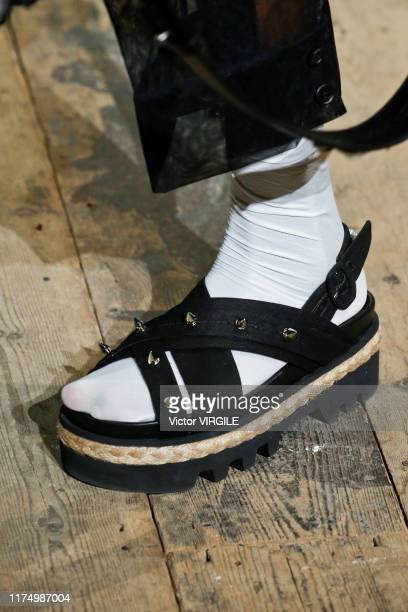 Model walks the runway at the Simone Rocha Ready to Wear Spring/Summer 2020 fashion show during London Fashion Week September 2019 on September 15,...