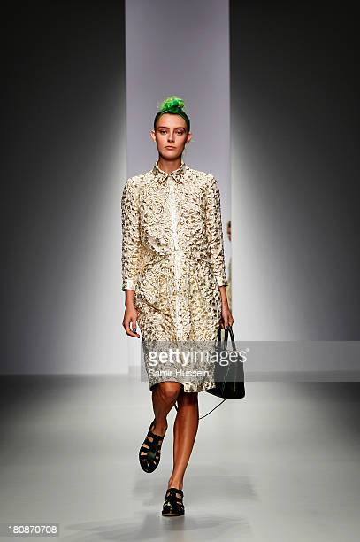 A model walks the runway at the Simone Rocha show during London Fashion Week SS14 at TopShop Show Space on September 17 2013 in London England