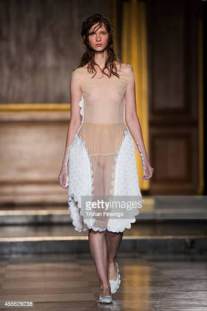 A model walks the runway at the Simone Rocha show during London Fashion Week Spring Summer 2015 on September 16 2014 in London England