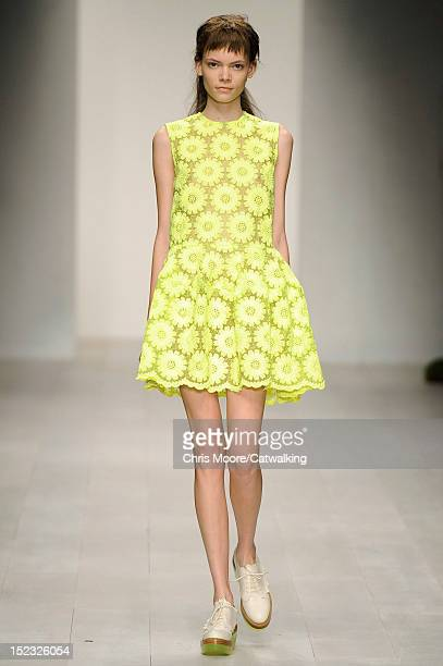 Model walks the runway at the Simone Rocha Spring Summer 2013 fashion show during London Fashion Week on September 18, 2012 in London, United Kingdom.