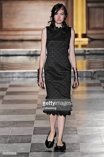 A model walks the runway at the Simone Rocha Spring Summer 2015 fashion show during London Fashion Week on September 16 2014 in London United Kingdom