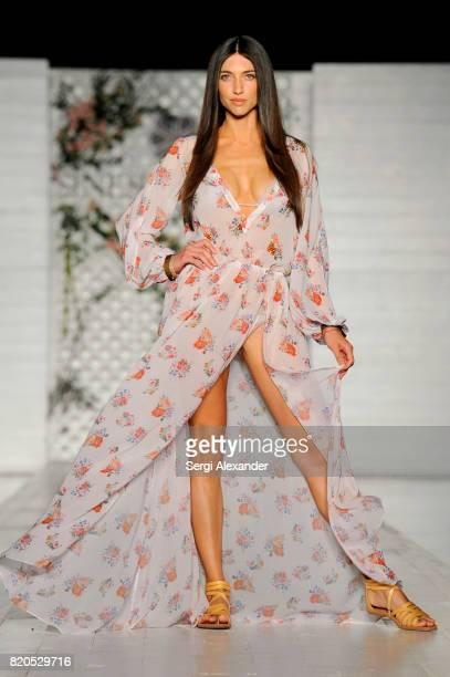 A model walks the runway at the SINESIA KAROL fashion show during FUNKSHION Swim Fashion Week at Nautilus Hotel on July 21 2017 in Miami Beach Florida