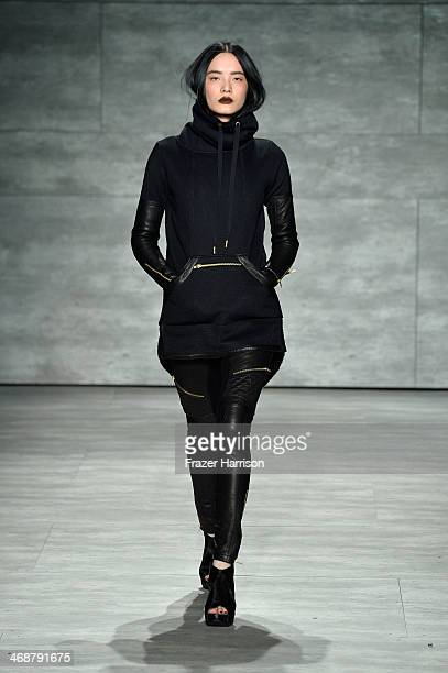 Model walks the runway at the Skingraft fashion show during Mercedes-Benz Fashion Week Fall 2014 at The Pavilion at Lincoln Center on February 11,...
