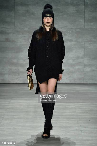 A model walks the runway at the Skingraft fashion show during MercedesBenz Fashion Week Fall 2014 at The Pavilion at Lincoln Center on February 11...