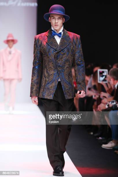 A model walks the runway at the SLAVA ZAITSEV fashion show during day one of Mercedes Benz Fashion Week Russia S/S 2018 at Manege on October 21 2017...