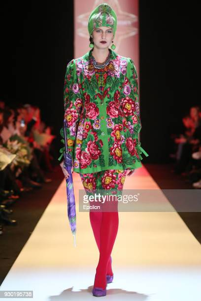 A model walks the runway at the Slava Zaitsev fashion show during day one of Mercedes Benz Fashion Week Russia Fall/Winter 2018/19 at Manege at...