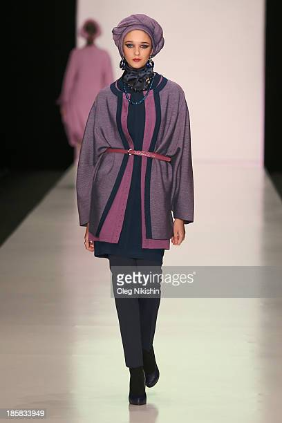 A model walks the runway at the SLAVA ZAITSEV For Ufa Knitwear LLCTM TRICARDO show during the MercedesBenz Fashion Week Russia S/S 2014 on October 25...