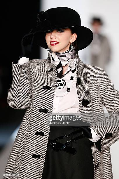 A model walks the runway at the SLAVA ZAITSEV PretAporter De Luxe show during MercedesBenz Fashion Week Russia S/S 2014 on October 26 2013 in Moscow...