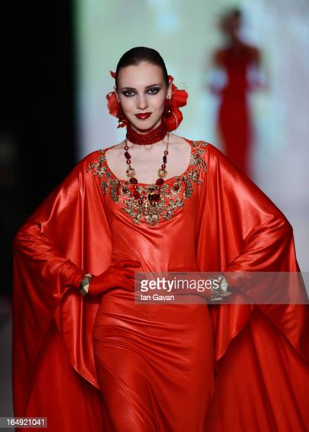 A model walks the runway at the Slava Zaitsev show during MercedesBenz Fashion Week Russia Fall/Winter 2013/2014 at Manege on March 29 2013 in Moscow...