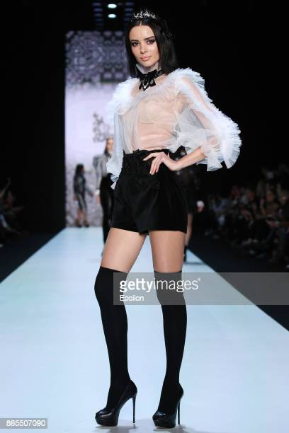 A model walks the runway at the Slava Zaitsev's Fashion Laboratory fashion show during day three of Mercedes Benz Fashion Week Russia S/S 2018 at...