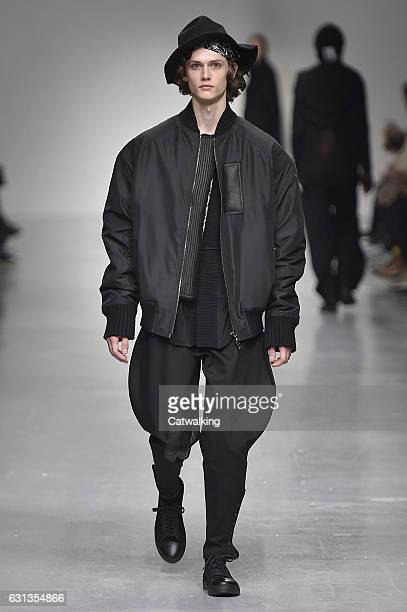 Model walks the runway at the Songzio Autumn Winter 2017 fashion show during London Menswear Fashion Week on January 9, 2017 in London, United...