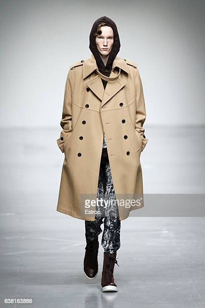 Model walks the runway at the SONGZIO show during London Fashion Week Men's January 2017 collections at BFC Show Space on January 9, 2017 in London,...