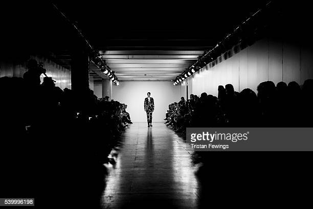A model walks the runway at the Songzio show during The London Collections Men SS17 at the BFC Show Space on June 10 2016 in London England