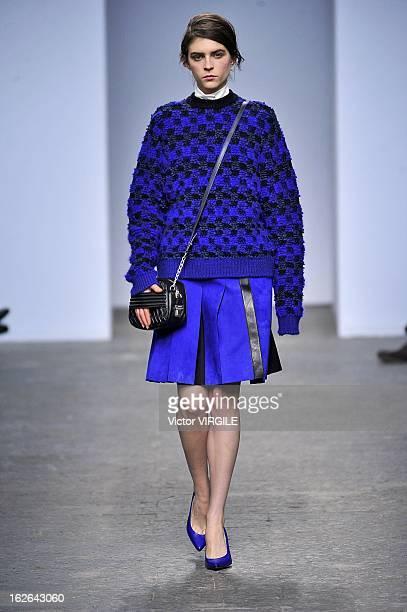 Model walks the runway at the Sportmax Ready to Wear Fall/Winter 2013-2014 fashion show during Milan Fashion Week Womenswear Fall/Winter 2013/14 on...