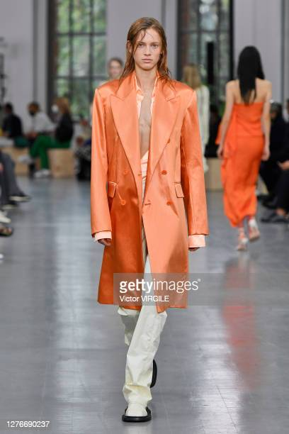 Model walks the runway at the Sportmax Ready to Wear Spring/Summer 2021 fashion show during the Milan Women's Fashion Week on September 25, 2020 in...