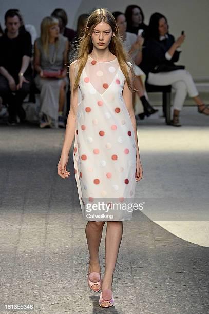 Model walks the runway at the Sportmax Spring Summer 2014 fashion show during Milan Fashion Week on September 20, 2013 in Milan, Italy.