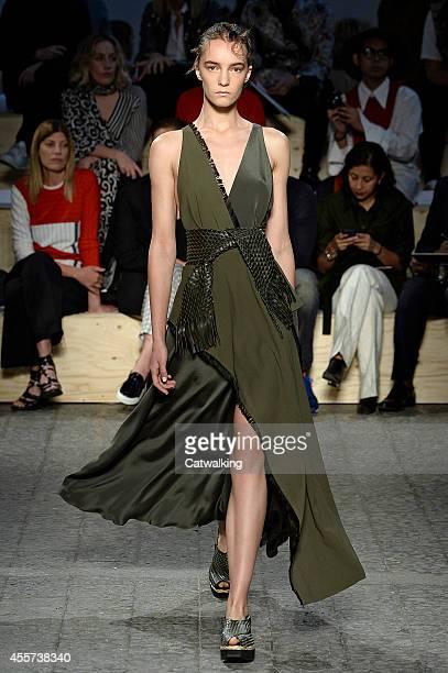 Model walks the runway at the Sportmax Spring Summer 2015 fashion show during Milan Fashion Week on September 19, 2014 in Milan, Italy.