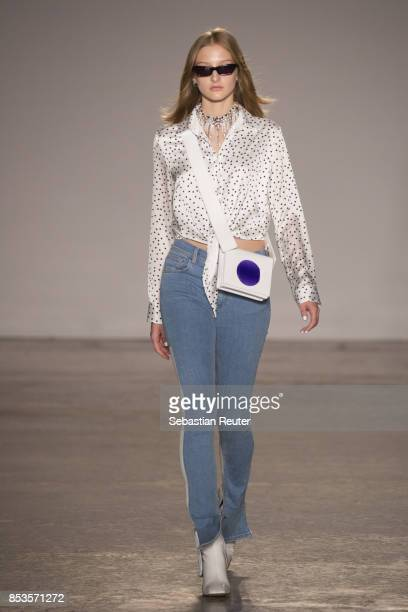 A model walks the runway at the Ssheena show during Milan Fashion Week Spring/Summer 2018 on September 25 2017 in Milan Italy