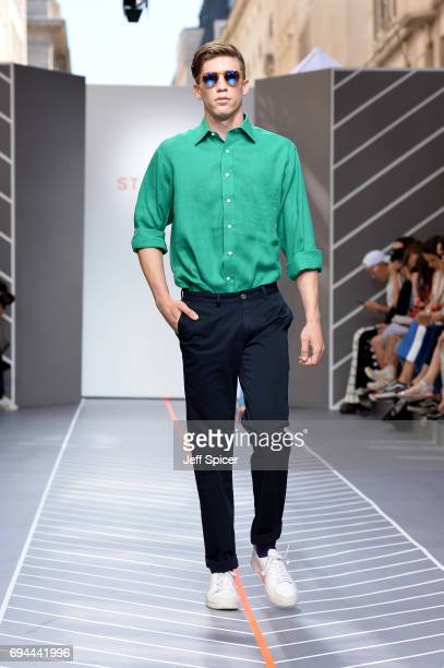 A model walks the runway at the St James's show during the London Fashion Week Men's June 2017 collections on June 10 2017 in London England