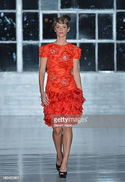 A model walks the runway at the St Wobil fashion show during MercedesBenz Fashion Week Spring 2014 at The Designer's Loft at Studio 450 on September...