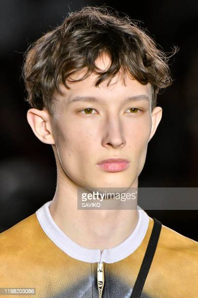 Model walks the runway at the Stefan Cooke Fall/Winter 2020-2021 fashion show during London Fashion Week Men's January 2020 on January 05, 2020 in...
