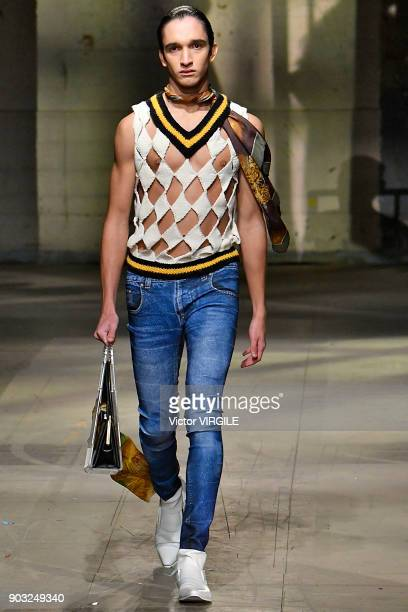 A model walks the runway at the Stefan Cooke for MAN show during London Fashion Week Men's January 2018 at Old Selfridges Hotel on January 7 2018 in...