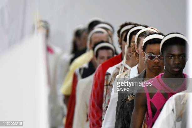 A model walks the runway at the Stefan Cooke Ready to Wear Spring/Summer 2020 fashion show during London Fashion Week Men's June 2019 on June 09 2019...